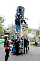 Water tower and guards of company hoarding water from thirsty people. MayDay Parade and Festival. Minneapolis Minnesota USA
