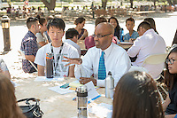 Ron Buckmire, Professor, Mathematics. Incoming first years meet with their faculty advisors during the Major Information Sessions & Advising part of Orientation in the Academic Quad, Aug. 24, 2015.<br /> (Photo by Marc Campos, Occidental College Photographer)