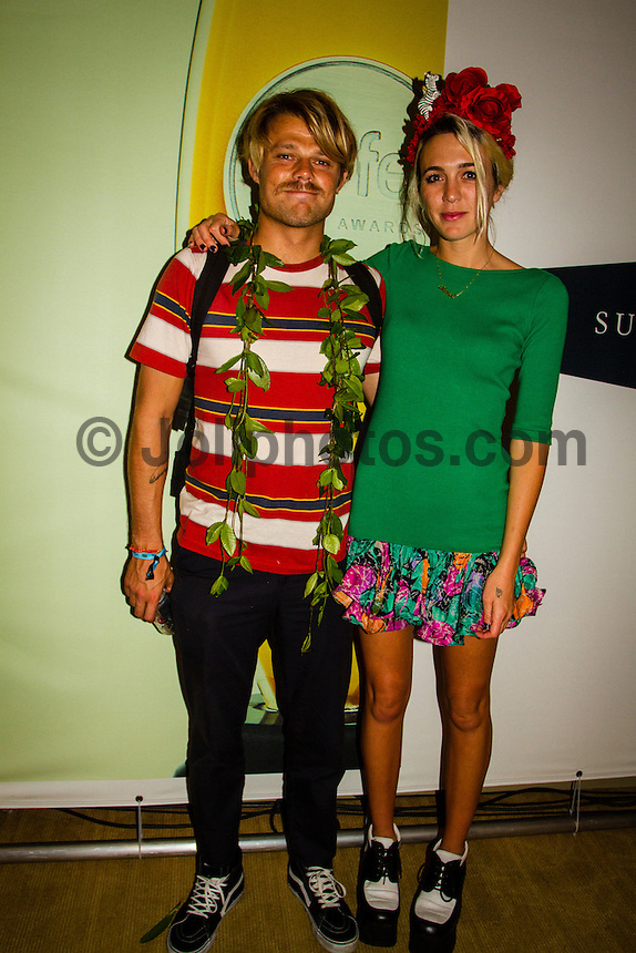 HONOLULU, Oahu, Turtle Bay Resort. Thursday 6th 2012. Dane Reynolds (USA) with girlfriend Courtney.Since moving the show to Oahu's North Shore three years ago, the 2012 SURFER Poll saw its largest turn out ever. From surfing's best to local legends, the packed house witnessed another historic night, as Kelly Slater (USA) and Stephanie Gilmore (AUS) won this year's Men's and Women's Polls. Gabriel Medina (BRA) won the Andy Irons Break Out Performer of the year award and finished #4 on the Surfer Poll while Dane Reynolds (USA) picked up two awards as well. Photo: joliphotos.com
