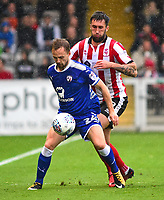 Chesterfield's Andy Kellett shields the ball from Lincoln City's Ollie Palmer<br /> <br /> Photographer Andrew Vaughan/CameraSport<br /> <br /> The EFL Sky Bet League Two - Lincoln City v Chesterfield - Saturday 7th October 2017 - Sincil Bank - Lincoln<br /> <br /> World Copyright &copy; 2017 CameraSport. All rights reserved. 43 Linden Ave. Countesthorpe. Leicester. England. LE8 5PG - Tel: +44 (0) 116 277 4147 - admin@camerasport.com - www.camerasport.com