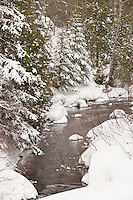 A snowy river nature scene near Copper Harbor Michigan in winter.