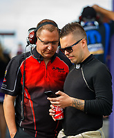 Apr 22, 2017; Baytown, TX, USA; NHRA funny car driver Jonnie Lindberg (right) with crew member during qualifying for the Springnationals at Royal Purple Raceway. Mandatory Credit: Mark J. Rebilas-USA TODAY Sports
