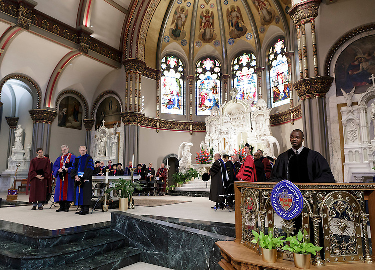 Rev. Keith Baltimore, university minister, offers an invocation during Academic Convocation at the St. Vincent de Paul Parish Church Thursday, Sept. 1, 2016, on the Lincoln Park campus. Marten denBoer, provost, provided remarks and many faculty and staff were recognized through annual awards and recognitions including: Excellence in Teaching, Spirit of Inquiry, Excellence in Public Service, Vincent de Paul Professorship, Spirit of DePaul, Staff Quality Service, Gerald Paetsch Academic Advising and faculty promotion and tenure. (DePaul University/Jeff Carrion)