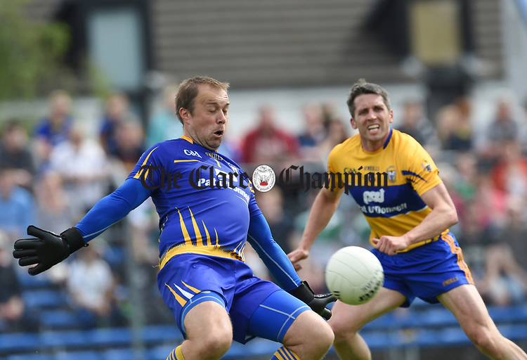Joe Hayes of Clare makes a save watched by Gordon Kelly during their Munster championship quarter-final game against Limerick in Cusack park. Photograph by John Kelly.