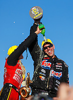 Feb 12, 2017; Pomona, CA, USA; NHRA top fuel driver Leah Pritchett (left) dumps Mello Yello soda on the head of pro stock driver Jason Line as they celebrate after winning the Winternationals at Auto Club Raceway at Pomona. Mandatory Credit: Mark J. Rebilas-USA TODAY Sports