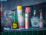 Bric-a-brac (bottles) in a shop window in the historic copper mining city of Butte, Montana