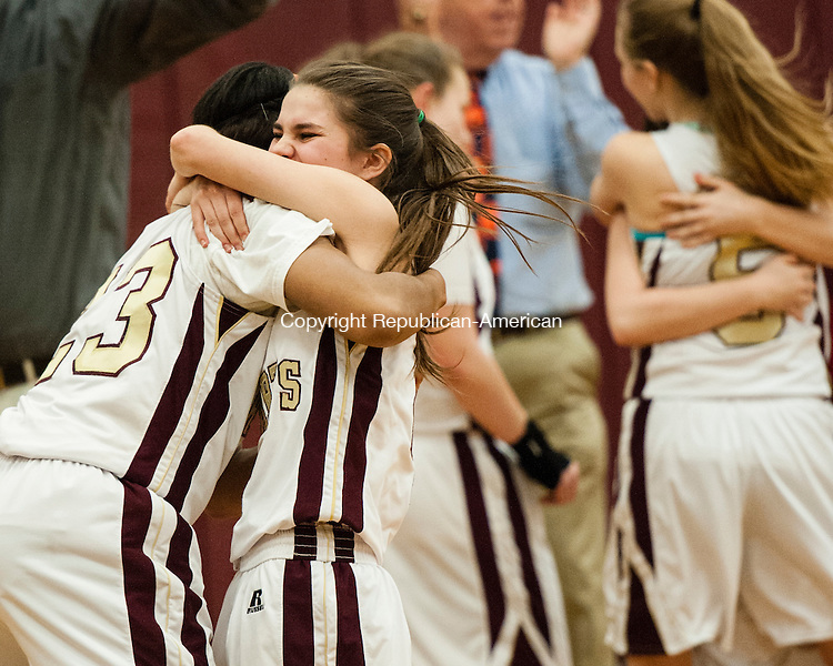 WATERBURY, CT-13 March 2014-031314EC03-    Sacred Heart's Mikyla Jacobs embraces Carlie Vaillancourt after the team's win Thursday night. The Hearts defeated Canton, 38-33, and will play Thomaston in the Class S semifinals. Erin Covey Republican-American