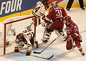 Dominic Toninato (UMD - 19), Merrick Madsen (Harvard - 31), Wiley Sherman (Harvard - 25) - The University of Minnesota Duluth Bulldogs defeated the Harvard University Crimson 2-1 in their Frozen Four semi-final on April 6, 2017, at the United Center in Chicago, Illinois.