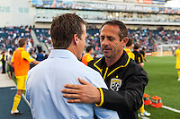 Columbus Crew head coach Robert Warzycha is greeted by Philadelphia Union manager John Hackworth prior to the match. The Philadelphia Union defeated the Columbus Crew 3-0 during a Major League Soccer (MLS) match at PPL Park in Chester, PA, on June 5, 2013.