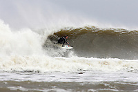Surfing at the Cove. Near Whitby , North Yorkshire ..October 2008..pic copyright Steve Behr / Stockfile