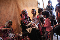 June 11, 2015 - Bekaa Valley, Lebanon: Syrian refugees women gather with their children inside a tent in a temporary shelter settled in Saadnayel city in east of Lebanon. All of them are refugees from Syria who fled years ago when opposition armed groups started battling against the government of President Bashar Al-Assad. (Photo/Narciso Contreras)