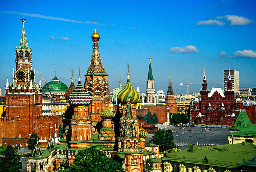 Red Square and walls of the Kremlin, St. Basil's Cathedral on left, Savior Tower behind, Moscow, Russia