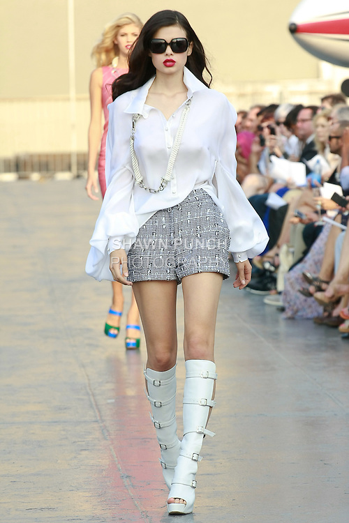 Michelle walks runway in a Douglas Hannant Resort 2012 outfit, on the USS Intrepid, June 7, 2011.