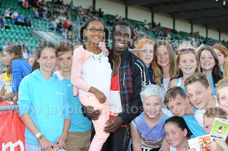International athletics at Cardiff International stadium, Cardiff, South Wales - Tuesday 15th July 2014<br /> <br /> Christian Malcolm is surrounded by his supporters having run his final race and retiring from athletics. <br /> <br /> <br /> Photo by Jeff Thomas Photography