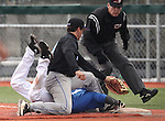 Wildcats' Tony Roque dives safely under the tag of SMCC's Garrett Gandolfo in the first game of a doubleheader against South Mountain Community College, at WNC in Carson City, Nev., on Friday, Jan. 25, 2013. WNC won the first game 5-1..Photo by Cathleen Allison