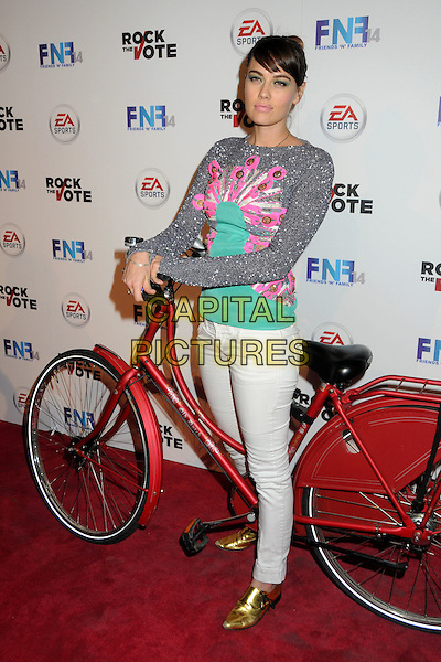 "CC SHEFFIELD.14th Annual ""Friends 'N' Family"" Grammy Event held at Paramount Studios, Los Angeles, California, USA..February 11th, 2011.full length jeans denim white grey gray turquoise blue pink top bike bicycle.CAP/ADM/BP.©Byron Purvis/AdMedia/Capital Pictures."