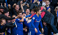 Cesar Azpilicueta (left) of Chelsea celebrates his goal with teammates & supporters during the Premier League match between Chelsea and Watford at Stamford Bridge, London, England on 21 October 2017. Photo by Andy Rowland.