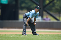 Umpire Isaias Barba handles the calls on the bases during the Carolina League game between the Buies Creek Astros and the Winston-Salem Dash at BB&T Ballpark on July 15, 2018 in Winston-Salem, North Carolina. The Dash defeated the Astros 6-4. (Brian Westerholt/Four Seam Images)
