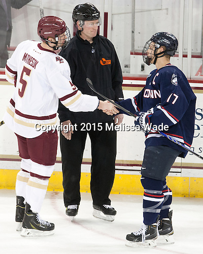 Michael Matheson (BC - 5), Kevin Keenan, Ryan Tyson (UConn - 17) - The Boston College Eagles defeated the visiting University of Connecticut Huskies 3-2 on Saturday, January 24, 2015, at Kelley Rink in Conte Forum in Chestnut Hill, Massachusetts.