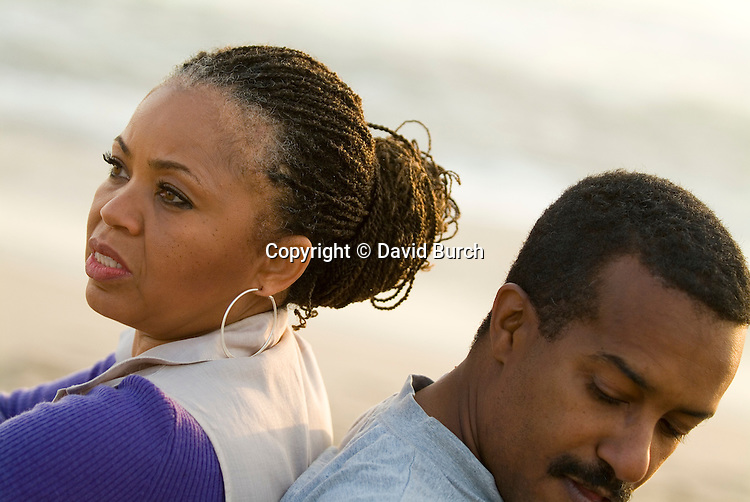 Mature couple at beach, thoughtful