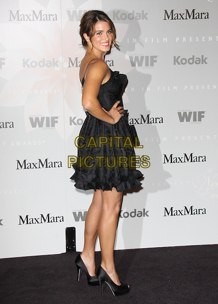 NIKKI REED.The 2010 Women in Film Crystal + Lucy Awards held at The  Hyatt Regency Century Plaza in Century City, California, USA..June 1st, 2010        .full length black dress frills ruffle peep toe shoes hand on hip side.CAP/RKE/DVS.©DVS/RockinExposures/Capital Pictures.