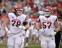 NWA Democrat-Gazette/ANDY SHUPE<br /> Arkansas offensive linemen Dalton Wagner (78) and Shane Clenin (57) jog to the sideline Saturday, April 6, 2019, during the Razorbacks' spring game in Razorback Stadium in Fayetteville. Visit nwadg.com/photos to see more photographs from the game.