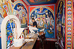 Iconographer Miloje Milinkovic paints icons and frescos on the wall of historic St. Sava Orthodox Church, Jackson, Calif.