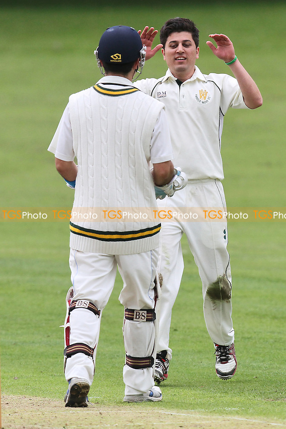 W Shafique of Harold Wood (R) celebrates the wicket of M Sexton - Harold Wood CC vs Leigh-on-Sea CC - Essex Cricket League at Harold Wood Park - 23/06/12 - MANDATORY CREDIT: Gavin Ellis/TGSPHOTO - Self billing applies where appropriate - 0845 094 6026 - contact@tgsphoto.co.uk - NO UNPAID USE.