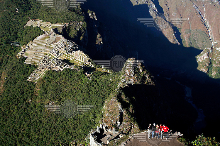 A group of tourists look up after climbing Huayna Picchu (Wayna Picchu) a site that overlooks Machu Picchu, the so-called 'Lost City of the Incas'.