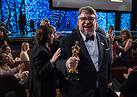 Guillermo del Toro poses with the Oscar&reg; for achievement in directing for work on &ldquo;The Shape of Water&rdquo; during the live ABC Telecast of The 90th Oscars&reg; at the Dolby&reg; Theatre in Hollywood, CA on Sunday, March 4, 2018.<br /> *Editorial Use Only*<br /> CAP/PLF/AMPAS<br /> Supplied by Capital Pictures