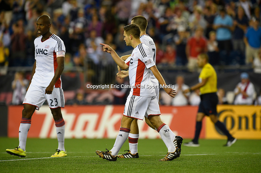July 30, 2014 - Foxborough, Massachusetts, U.S. - New England Revolution's Kelyn Rowe (11) gestures after scoring a goal during the MLS game between the Colorado Rapids and the New England Revolution held at Gillette Stadium in Foxborough Massachusetts. The New England Revolution defeated the Colorado Rapids 3-0. Eric Canha/CSM