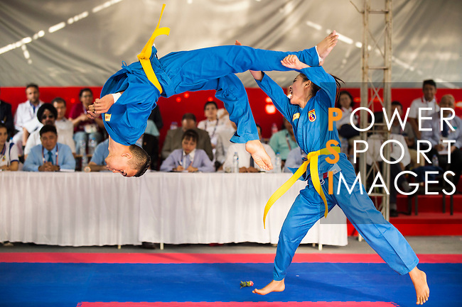 CHANTHALACKSA Mala and SIHALATH Ketsada of Laos in action during the Vovinam Mixed Events Self-defense for Women on Day Eight of the 5th Asian Beach Games 2016 at Bien Dong Park on 01 October 2016, in Danang, Vietnam. Photo by Marcio Machado / Power Sport Images