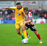 Morecambe's Aaron Wildig vies for possession with Lincoln City's Alex Woodyard<br /> <br /> Photographer Andrew Vaughan/CameraSport<br /> <br /> The EFL Sky Bet League Two - Lincoln City v Morecambe - Saturday August 12th 2017 - Sincil Bank - Lincoln<br /> <br /> World Copyright &copy; 2017 CameraSport. All rights reserved. 43 Linden Ave. Countesthorpe. Leicester. England. LE8 5PG - Tel: +44 (0) 116 277 4147 - admin@camerasport.com - www.camerasport.com