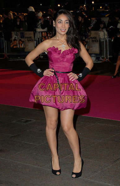 "SOFIA HYATT.Attends the UK Premiere of ""Music & Lyrics"",.Odeon Leicester Square, .London, England, February 5th 2006..full length sophia pink strapless dress hand on hips black gloves shoes.CAP/CAN.©Can Nguyen/Capital Pictures"