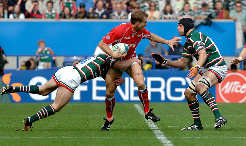 Photo: Richard Lane..Leicester Tigers v Llanelli Scarlets. Heineken Cup, Semi Final. 21/04/2007. .Scarlets' Daffyd James is held by the Tigers' defence.