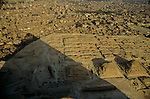 Egypt's Old Kingdom; Great Pyramid of Khufu casts a shadow on boat pits, mastaba tombs and Queen's pyramids, The Pyramids of Giza; Giza Plateau; South of Cairo; Egypt
