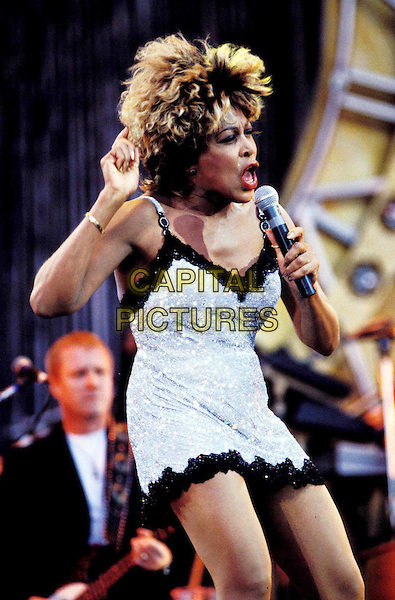 TINA TURNER..Ref: 3087..performing live in concert, singing, music, stage, half length, half-length, glitter, sparkle, miniskirt..www.capitalpictures.com..sales@capitalpictures.com..©Capital Pictures
