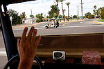 Bill Pearson drives through Sun City in his golf cart...2010 marks the 50th anniversary of the United States' first planned retirement city. When Del Webb created Sun City and it opened in 1960, it was a revolutionary idea for retirees to move away from home and to live extremely active and social lifestyles..