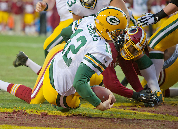 Washington Redskins defensive end Preston Smith (94) sacks Green Bay Packers quarterback Aaron Rodgers (12) for a safety early in the first quarter of the NFC Wild Card game at FedEx Field in Landover, Maryland on Sunday, January 10, 2016.<br /> Credit: Ron Sachs / CNP/MediaPunch ***FOR EDITORIAL USE ONLY***