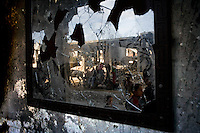 Rafah, Gaza Strip, Jan 15 2009.Children play near buildings damaged during an Israeli airstrike..