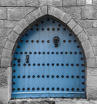 Old blue door at Poble Espanyol complex in Barcelona, Spain.<br />