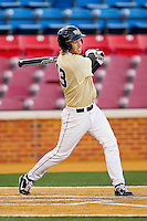 Grant Shambley #43 of the Wake Forest Demon Deacons follows through on his swing against the Georgetown Hoyas at Wake Forest Baseball Park on February 26, 2012 in Winston-Salem, North Carolina.  The Demon Deacons defeated the Hoyas 5-2.  (Brian Westerholt / Four Seam Images)