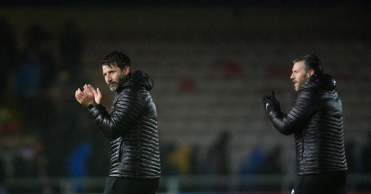 Lincoln City manager Danny Cowley, left, and Lincoln City's assistant manager Nicky Cowley applaud the fans at the final whistle<br /> <br /> Photographer Chris Vaughan/CameraSport<br /> <br /> The EFL Sky Bet League Two - Saturday 15th December 2018 - Lincoln City v Morecambe - Sincil Bank - Lincoln<br /> <br /> World Copyright © 2018 CameraSport. All rights reserved. 43 Linden Ave. Countesthorpe. Leicester. England. LE8 5PG - Tel: +44 (0) 116 277 4147 - admin@camerasport.com - www.camerasport.com