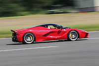 Chris Evans drives his Ferrari LaFerrari around the track during The Children's Trust Supercar Event at Dunsfold Park, Surrey, England on 22 June 2014. Photo by Andy Rowland.