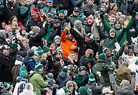 A Michigan State Spartans fan holds up the football after Ohio State Buckeyes punter Drue Chrisman, not pictured, kicked the ball into the stands during a punt attempt in the first quarter of a NCAA college football game between the Michigan State Spartans and the Ohio State Buckeyes on Saturday, November 10, 2018 at Spartan Stadium in East Lansing, Michigan. [Joshua A. Bickel/Dispatch]
