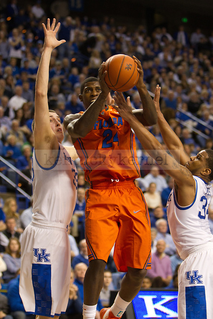 Sophomore F Kyle Wiltjer (33) and Senior G Julius Mays attempt to stop Florida's Casey Prather (24) during the UK vs Florida Men's basketball game in Lexington, Ky., on Saturday, March 9, 2013. Photo by Matt Burns | Staff