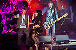 © Joel Goodman - 07973 332324 . 01/07/2017 . Manchester , UK . Bez (Mark Berry) , Rowetta Idah and Peter Hook . Hacienda Classical play at the Castlefield Bowl as part of Sounds of the City , during the Manchester International Festival . A collaboration between DJs Mike Pickering and Graeme Park and the Manchester Camerata orchestra , Hacienda Classical reworks music by bands including the Happy Mondays and New Order and features Manchester musicians including Rowetta and Peter Hook . Photo credit : Joel Goodman