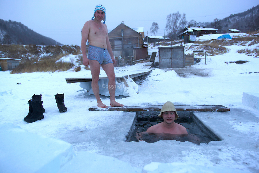 Banya  or bathing in a icy hole in the cold water of the baikal lake ! Siberian said that you earn 10 years of life if you do it !.