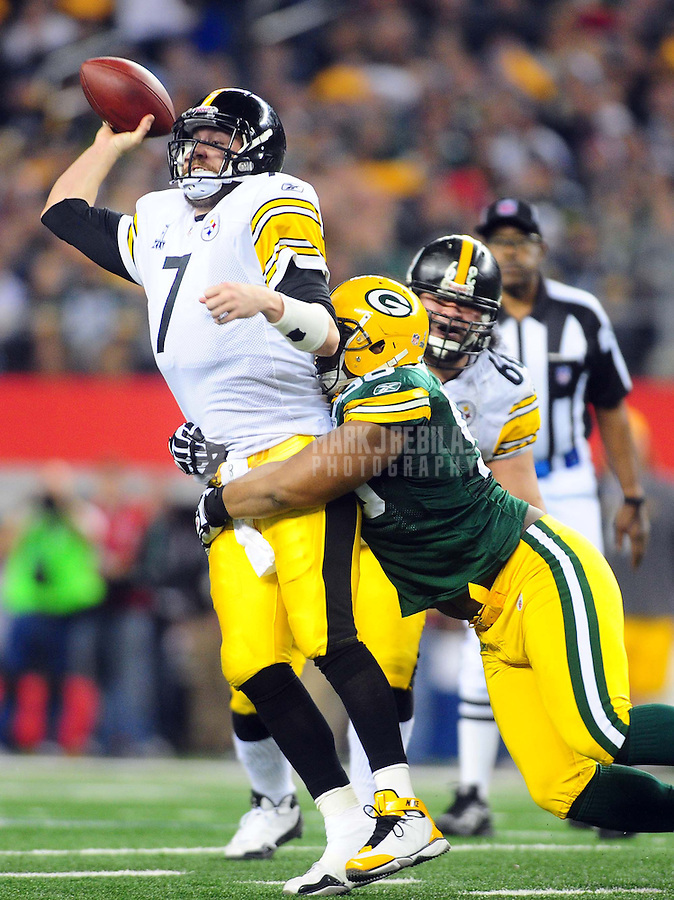Feb 6, 2011; Arlington, TX, USA; Pittsburgh Steelers quarterback Ben Roethlisberger (7) releases a pass as he is hit by Green Bay Packers defensive tackle B.J. Raji (90) during the second half of Super Bowl XLV at Cowboys Stadium.  Mandatory Credit: Mark J. Rebilas-