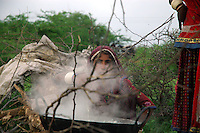 A woman in the bush, boiling milk into mawa ..by Michael Benanav - mbenanav@gmail.com